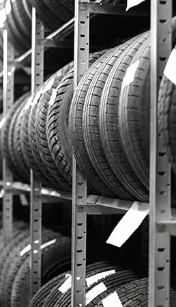 Black and white image of a rack of tires